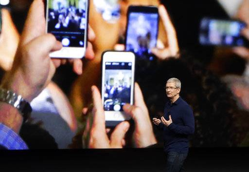 FILE - In this Wednesday, Sept. 7, 2016, file photo, Apple CEO Tim Cook announces the new iPhone 7 during an event to announce new products, in San Francisco. Apple is expected to demand $1,000 for the fanciest iPhone that it has ever made, thrusting the market into a new financial frontier that will test how much consumers are willing to pay for a device that has become an indispensable part of modern life. The unveiling of the dramatically redesigned iPhone will likely be the marquee moment Tuesday, Sept. Sept. 12 when Apple hosts its first event at its new Cupertino, Calif., headquarters. (AP Photo/Marcio Jose Sanchez, File)
