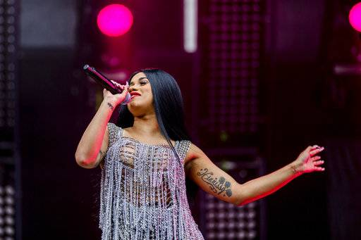 "FILE - In this Saturday, Sept. 2, 2017, file photo, Cardi B performs at The Budweiser Made In America Festival in Philadelphia. Cardi B has a breakthrough hit with ""Bodak Yellow (Money Moves)"" and the rapper said she's ready to follow the single's success with an album next month. (Photo by Michael Zorn/Invision/AP, File)"
