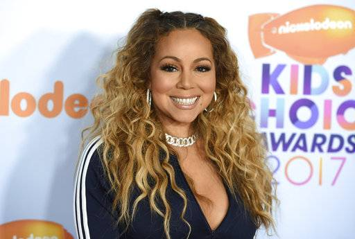 "FILE - In this Saturday, March 11, 2017, file photo, Mariah Carey arrives at the Kids' Choice Awards at the Galen Center in Los Angeles. Carey's many collaborations with rap artists will be celebrated at the 2017 VH1 Hip Hop Honors. VH1 said Monday, Sept. 11, that the singer will be honored at the Sept. 17 taping, dubbed ""Hip Hop Honors: The 90's Game Changers,� at Paramount Studios in Hollywood. It will air Sept. 18. (Photo by Jordan Strauss/Invision/AP, File)"