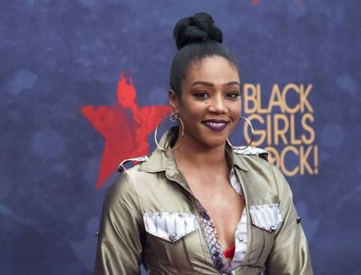 "In this Aug. 5, 2017, photo, Tiffany Haddish attends the Black Girls Rock! Awards at the New Jersey Performing Arts Center in Newark, N.J. Actress and comedian Haddish is having a full-circle moment. The breakout star of the summer movie hit ""Girls Trip"" launched her career on ""Def Comedy Jam,"" the long-running HBO series spotlighting black comics, and now she's appearing on its 25th anniversary tribute. (Photo by Charles Sykes/Invision/AP)"