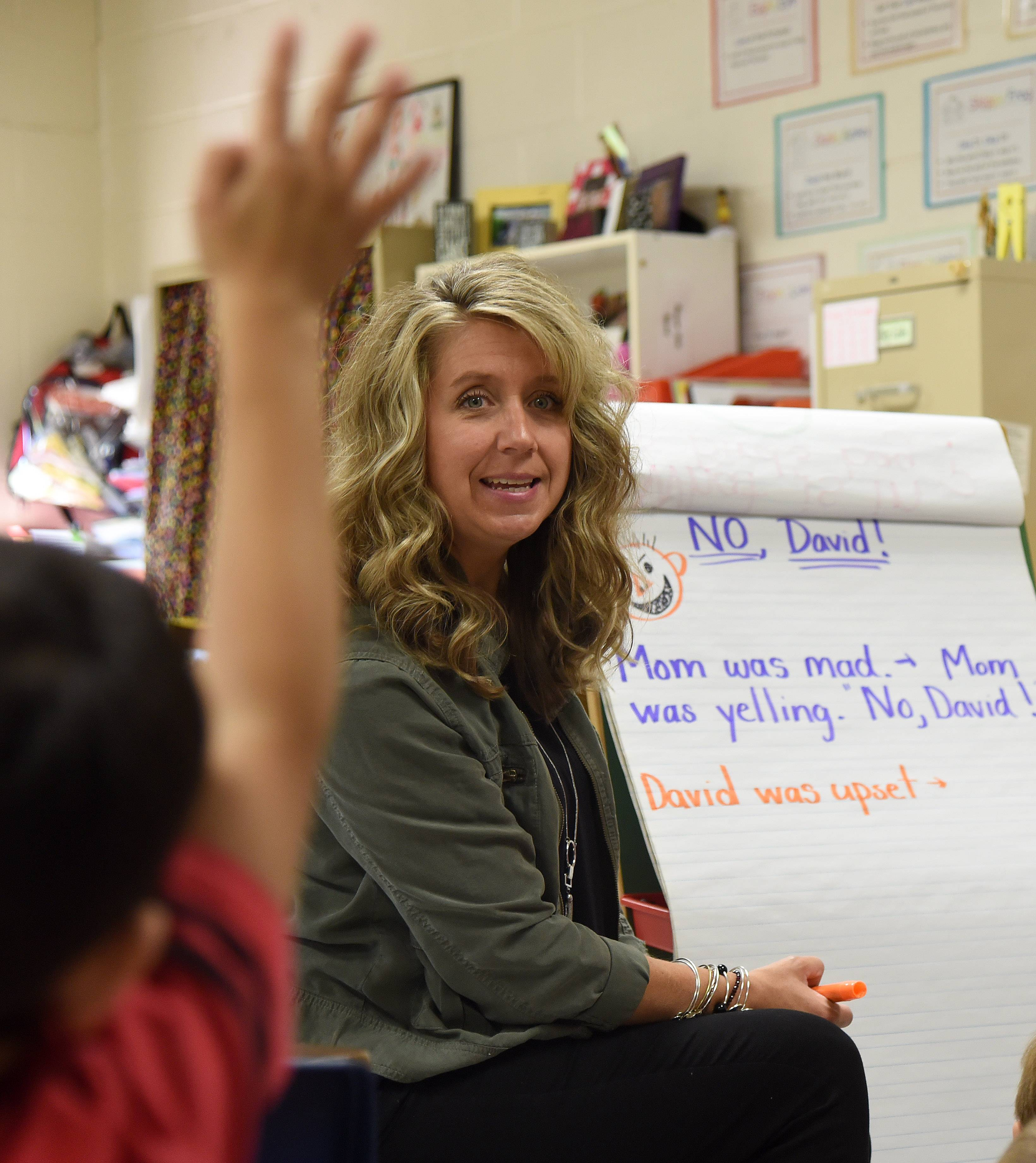 "First-grade teacher Jodi Bird talks about the book ""No, David!"" with her H.C. Storm Elementary School students in Batavia Wednesday. ."