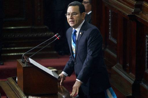 FILE - In this Jan. 14, 2017 file photo, Guatemala's President Jimmy Morales delivers his first annual State of the Nation address to Congress in Guatemala City. A five-member commission of legislators has recommended lifting Morales' immunity from prosecution so he can face possible trial on campaign-financing accusations. Commission head Julio Ixcamey said late Sept. 10, 2017 the recommendation will be submitted to the full congress for a vote. (AP Photo/Moises Castillo, File)