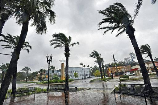Palms blow in strong winds and rain in San Marco as Hurricane Irma passes by Monday, Sept. 11, 2017, in Jacksonville, Fla. (Will Dickey/The Florida Times-Union via AP)