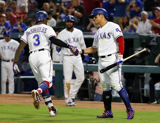 Texas Rangers' Delino DeShields (3) and Shin-Soo Choo, right, of South Korea celebrate DeShields solo home run in the fourth inning of a baseball game against the Seattle Mariner, Monday, Sept. 11, 2017, in Arlington, Texas. (AP Photo/Tony Gutierrez)