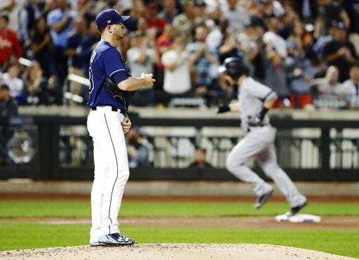 Tampa Bay Rays starting pitcher Jake Odorizzi reacts as New York Yankees' Todd Frazier runs the bases after hitting a three-run home run during the fourth inning of a baseball game, Monday, Sept. 11, 2017, in New York. (AP Photo/Frank Franklin II)