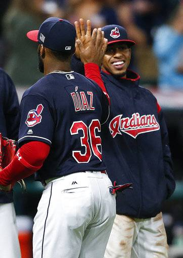 Cleveland Indians' Francisco Lindor, right, and Yandy Diaz (36) celebrate a 11-0 victory over the Detroit Tigers in a baseball game, Monday, Sept. 11, 2017, in Cleveland. (AP Photo/Ron Schwane)