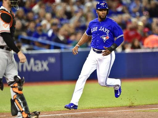 Toronto Blue Jays' Teoscar Hernandez runs to home plate as he scores on a sacrifice hit by teammate Ryan Goins during inning American League MLB baseball action against the Baltimore Orioles in Toronto on Monday, Sept. 11, 2017. (Frank Gunn/The Canadian Press via AP)