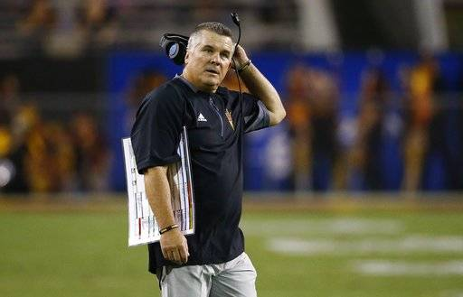 Arizona State coach Todd Graham stands on the field during the first half of the team's NCAA college football game against San Diego State on Saturday, Sept. 9, 2017, in Tempe, Ariz. (AP Photo/Ross D. Franklin)