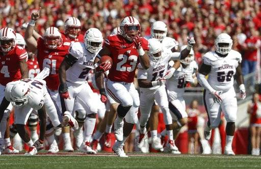 Wisconsin's Jonathan Taylor breaks away for a touchdown run during the first half of an NCAA college football game against Florida Atlantic Saturday, Sept. 9, 2017, in Madison, Wis. (AP Photo/Morry Gash)