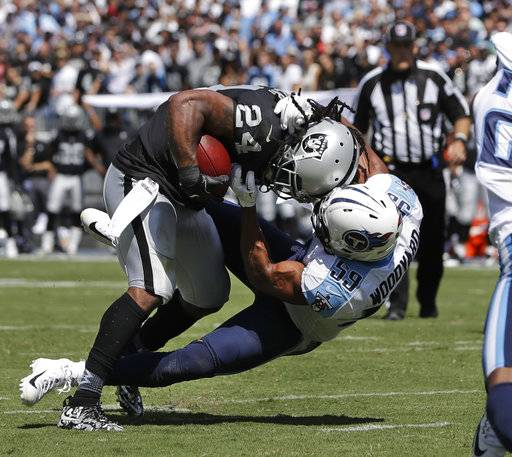 Oakland Raiders running back Marshawn Lynch (24) is brought down at the 2-yard line by Tennessee Titans inside linebacker Wesley Woodyard (59) in the first half of an NFL football game Sunday, Sept. 10, 2017, in Nashville, Tenn. (AP Photo/James Kenney)