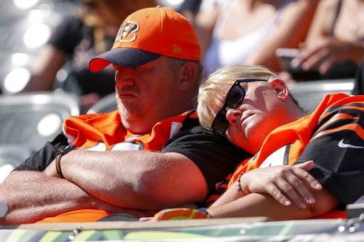 Cincinnati Bengals fans rest in the second half of an NFL football game against the Baltimore Ravens, Sunday, Sept. 10, 2017, in Cincinnati. (AP Photo/Gary Landers)