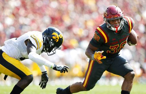 Iowa State running back David Montgomery (32) runs from Iowa defensive back Michael Ojemudia, left, during the second half of an NCAA college football game, Saturday, Sept. 9, 2017, in Ames, Iowa. Iowa won 44-41 in overtime. (AP Photo/Charlie Neibergall)