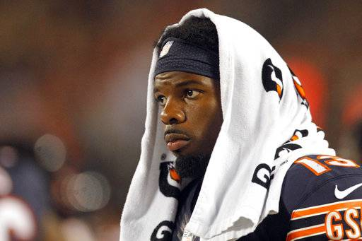 FILE - In this Aug. 11, 2016, file photo, Chicago Bears wide receiver Kevin White watches from the sideline during the second half of the team's NFL preseason football game against the Denver Broncos, in Chicago. White suffered a broken collarbone against the Atlanta Falcons and will go on injured reserve for the third straight season. The seventh pick of the 2015 draft, White was injured in the fourth quarter of Sunday's, Sept. 10, 2017, season-opening loss and came off the field immediately, favoring the shoulder slightly. The team confirmed the severity of the injury Monday. (AP Photo/Tae-Gyun Kim, File)