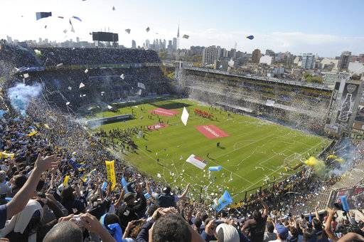 FILE - In this May 4, 2008 file photo, Boca Juniors fans cheer prior to an Argentine soccer league game against River Plate at La Bombonera stadium in Buenos Aires. Peruvian football officials have on Monday, Sept. 11, 2017, asked FIFA to shift the World Cup qualifier against Argentina next month from Boca Junior's Bombonera stadium. (AP Photo/Daniel Luna, File)