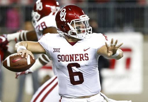 Oklahoma quarterback Baker Mayfield drops back to pass against Ohio State during the first half of an NCAA college football game Saturday, Sept. 9, 2017, in Columbus, Ohio. (AP Photo/Jay LaPrete)
