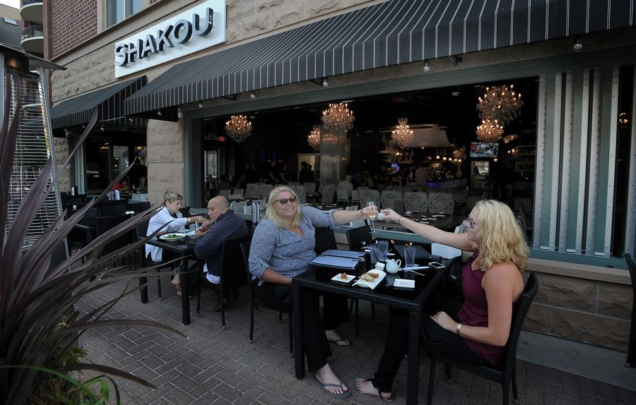 Fine dining outdoors is among the attractions in downtown Arlington Heights  - and many other suburbs.