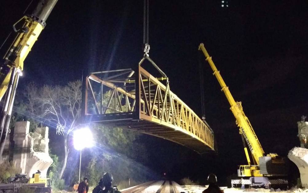 Crews prepare to install a 220-foot-long steel bridge over Metra tracks to connect the Middlefork Savanna Forest Preserve to Lake Forest Academy and south to Lake Forest's Townline Community Park.