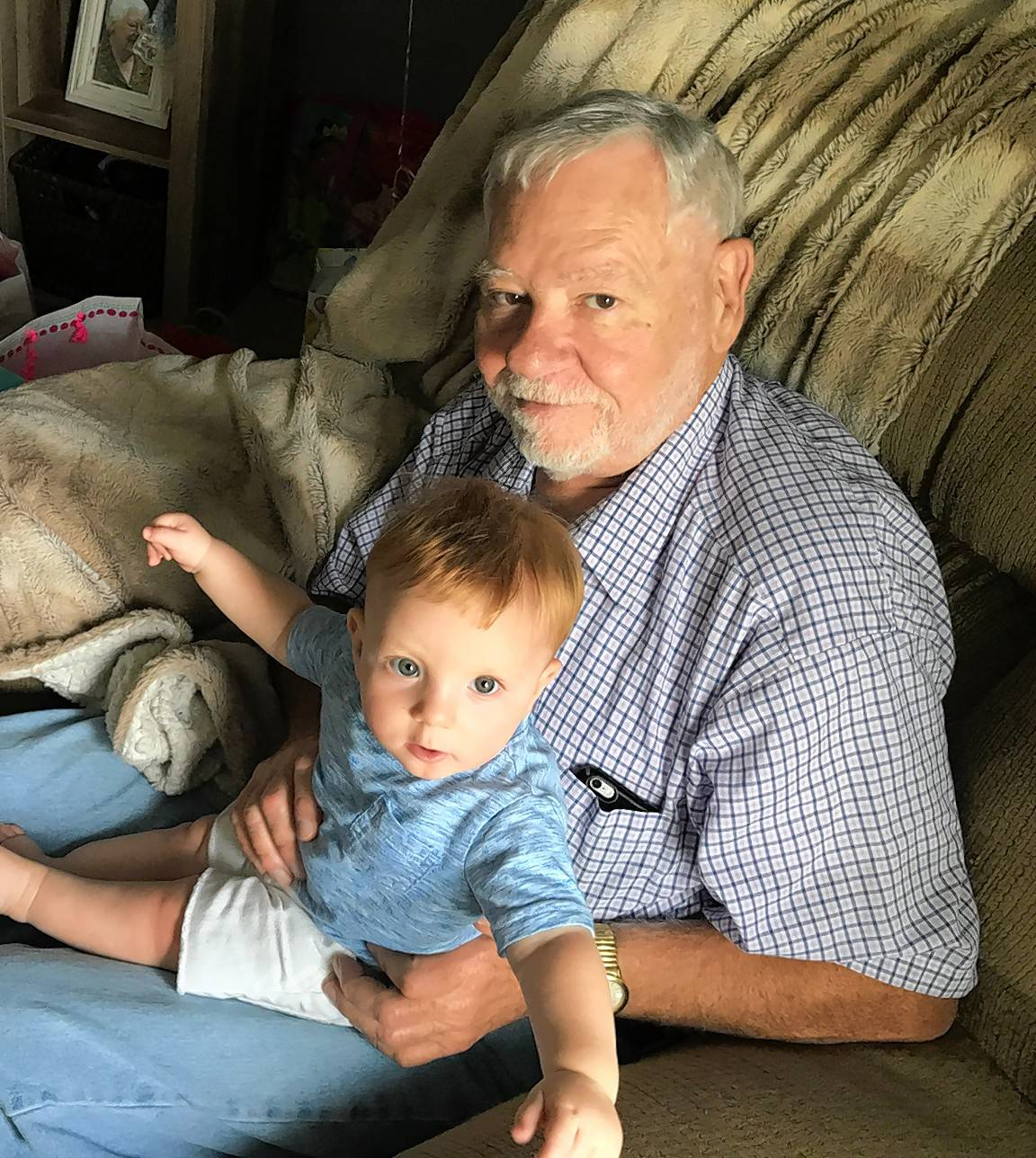 Jim Putman, 72, of Elgin is pictured Sept. 3 with his great-grandson Michael. He was severely injured the next day while driving through Ohio.