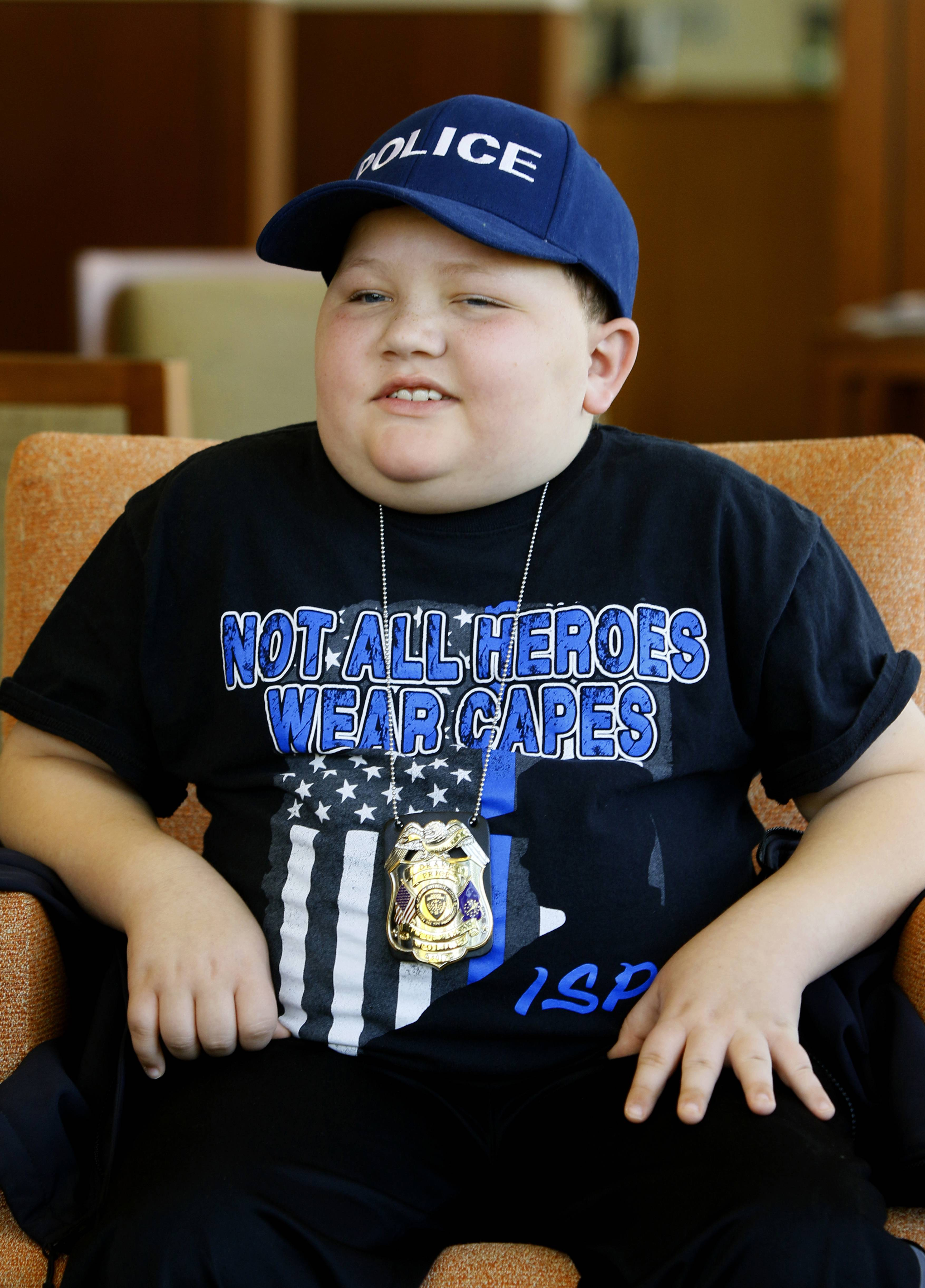 "Drake Price wants to be a police officer, which is why he found it ""exciting"" Tuesday when a SWAT vehicle and several DuPage County sheriff's office personnel visited him after his treatment at Northwestern Medicine Chicago Proton Center."