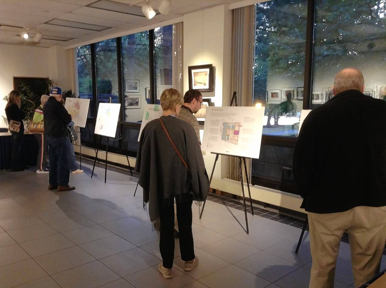 Schaumburg residents view maps and other materials on the draft revision of the village's comprehensive land-use plan Monday during an open house at the Al Larson Prairie Center for the Arts.