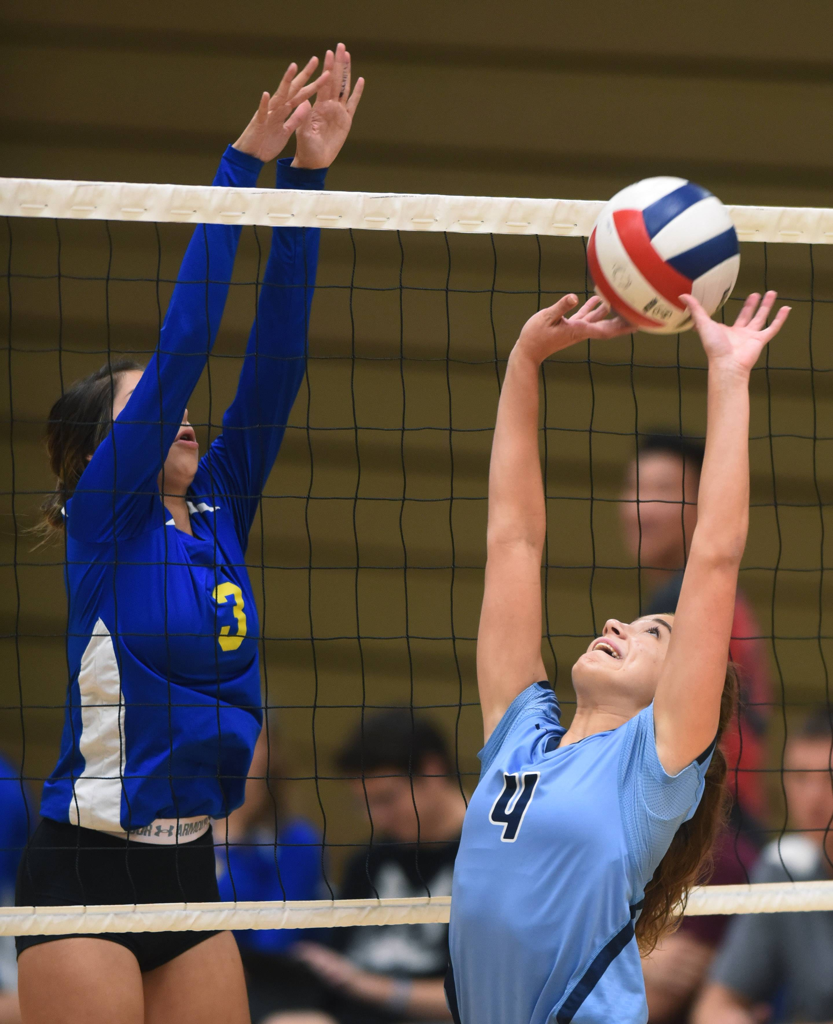 Prospect's Sarah Skaggs sets the ball in front of Wheeling's Nicole Nguyen during Tuesday's match in Wheeling.