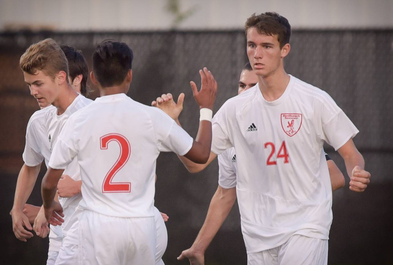 Naperville Central's Nico Couropmitree (2) congratulates teammate Cameron Strang (24) on his first half goal against Neuqua Valley during varsity boys soccer in Naperville on September 12, 2017.