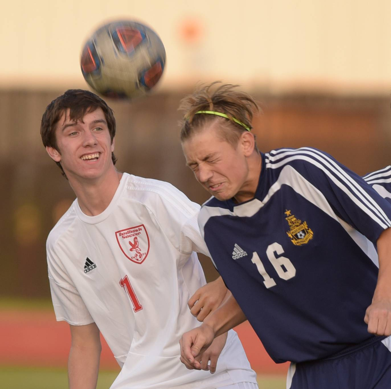 Naperville Central's Brad Palagi (1) and Neuqua Valley's Nate Kuper (16) battle for control of the ball during varsity boys soccer in Naperville on September 12, 2017.