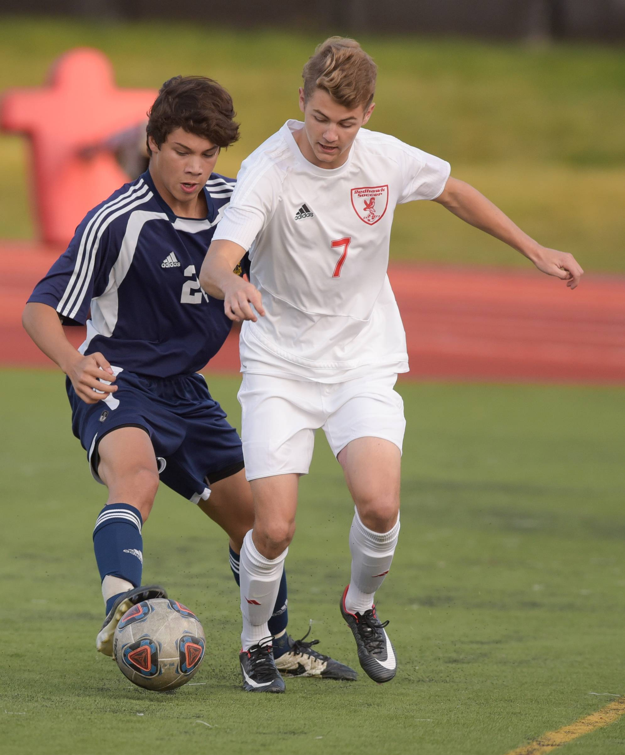 Neuqua Valley's Jose Navarro (21) chase down Naperville Central's Ryan Coleman (7) during varsity boys soccer in Naperville on September 12, 2017.