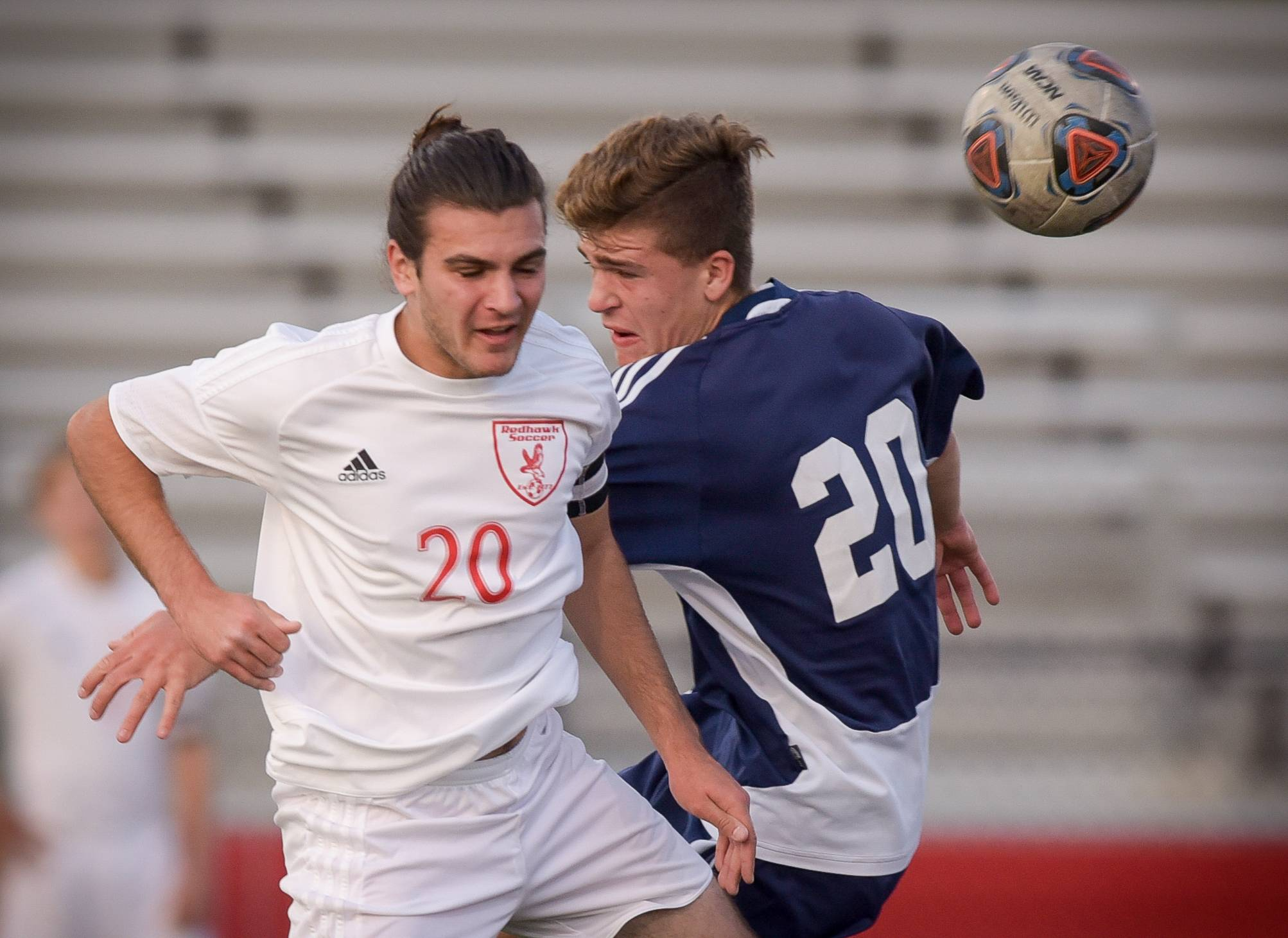 Naperville Central's Nate Zain (20) and Neuqua Valley's Parker Domschke (20) battle for control of the ball during varsity boys soccer in Naperville on September 12, 2017.