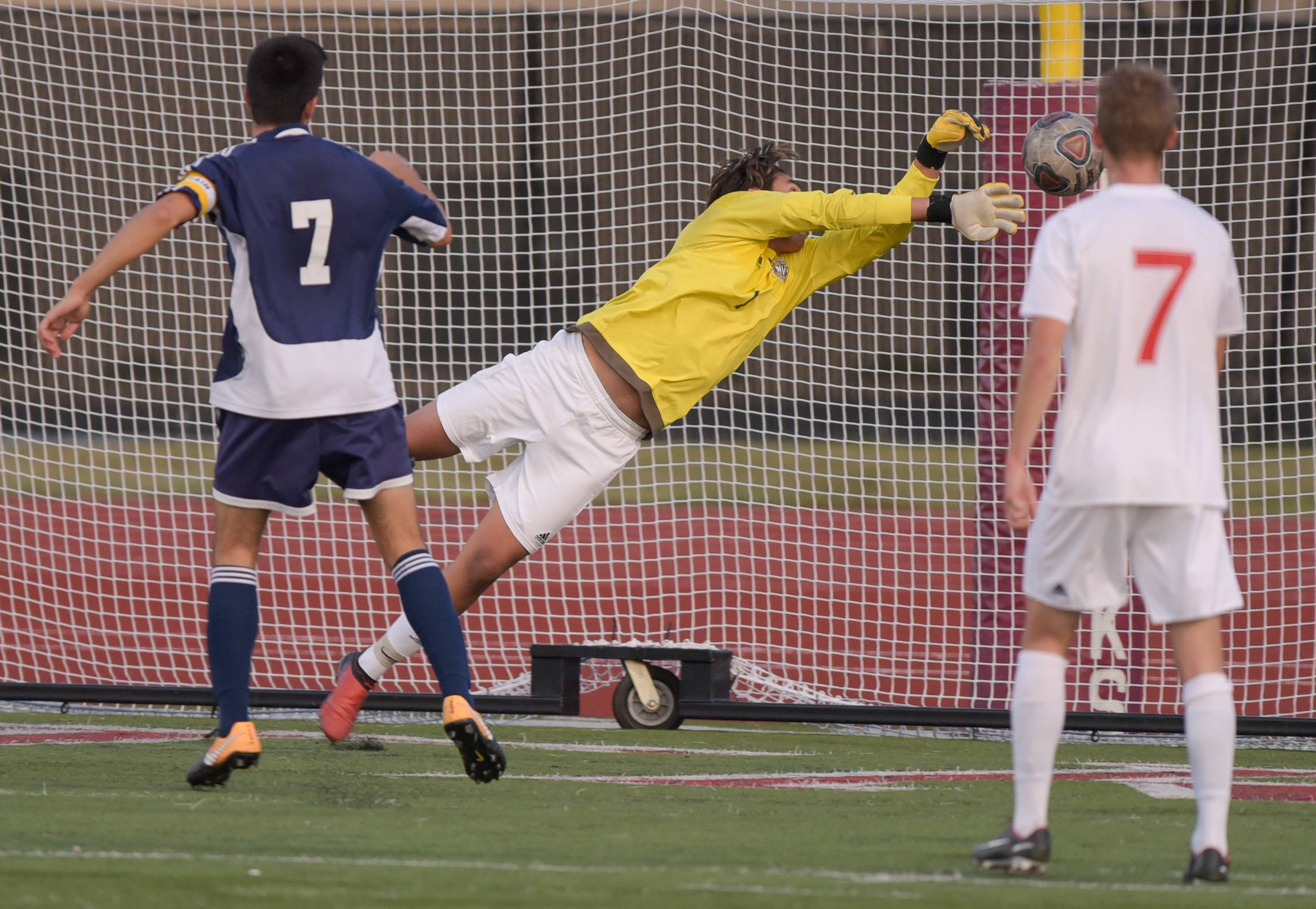 Neuqua Valley's Dylan Soto (1) comes up short on a diving block of a shot on goal by Naperville Central's Cameron Strang (24) during varsity boys soccer in Naperville on September 12, 2017.