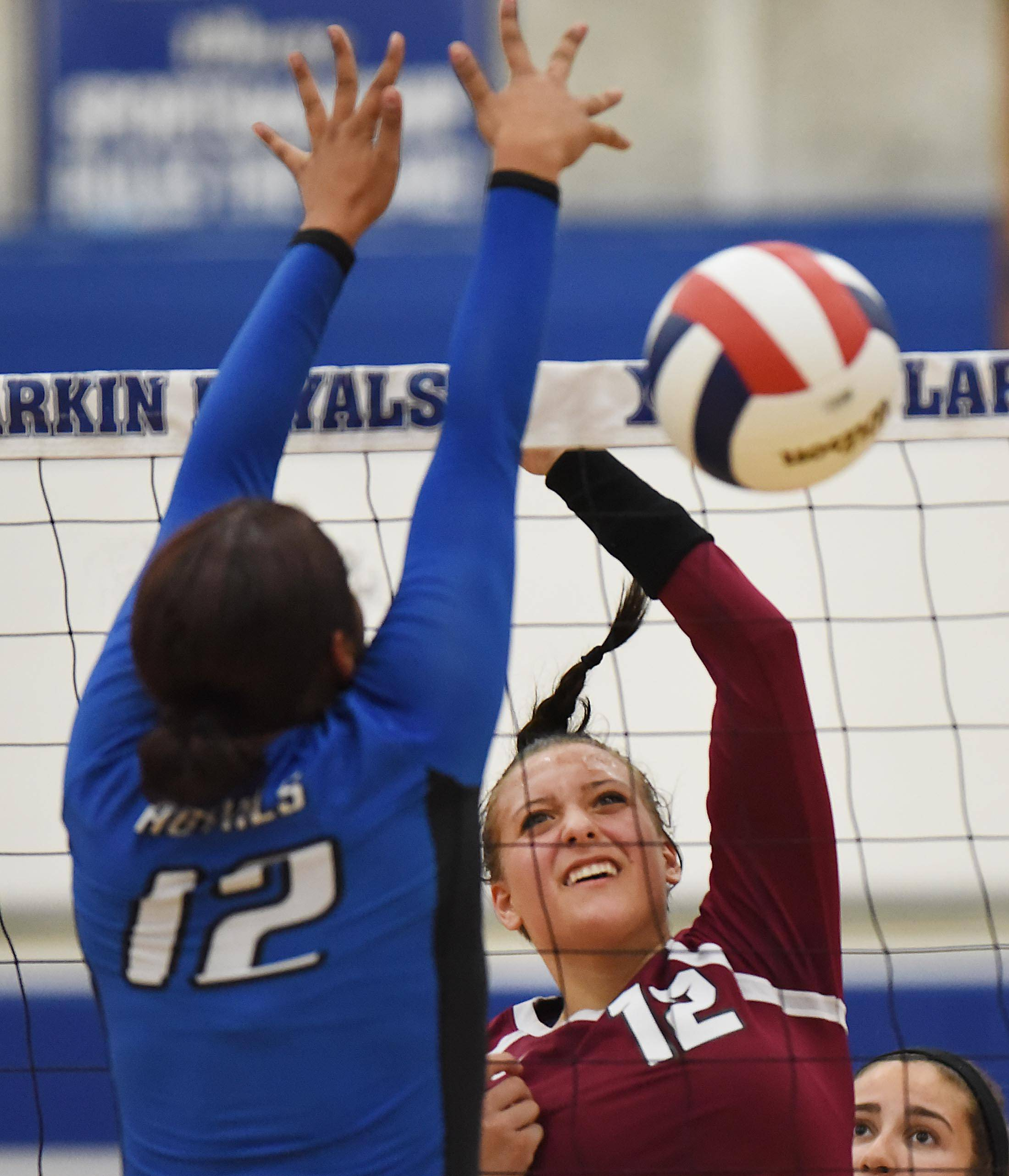 Elgin's Inga Suceska scores against Larkin's Jaelihn Norman Tuesday at Larkin High School in Elgin.