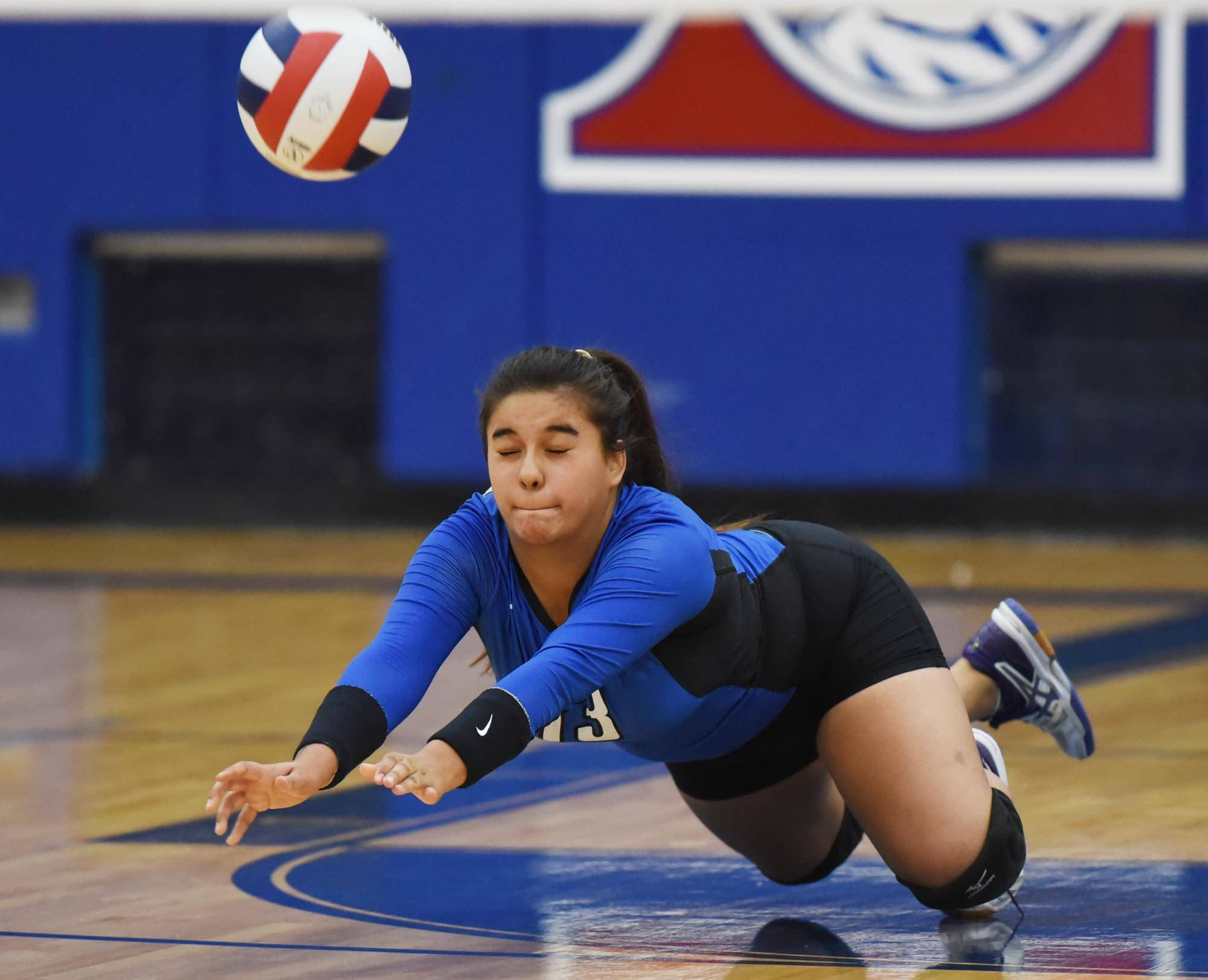 Larkin's Claribel Hernandez tries to dig an Elgin shot  Tuesday at Larkin High School in Elgin.