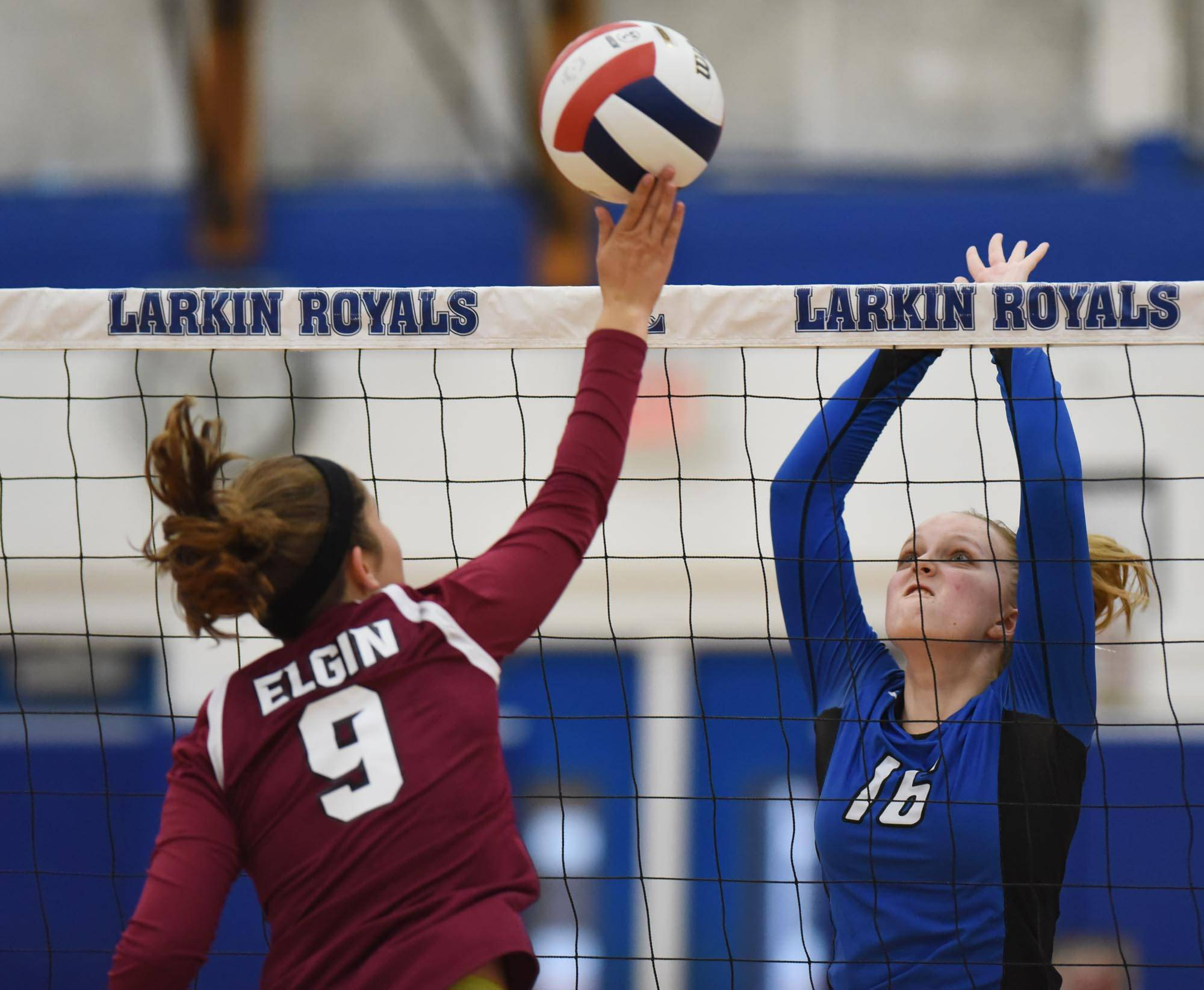 Larkin's Madison Payleitner goes up to stop a shot by Elgin's Madeline Schaefer Tuesday at Larkin High School in Elgin.
