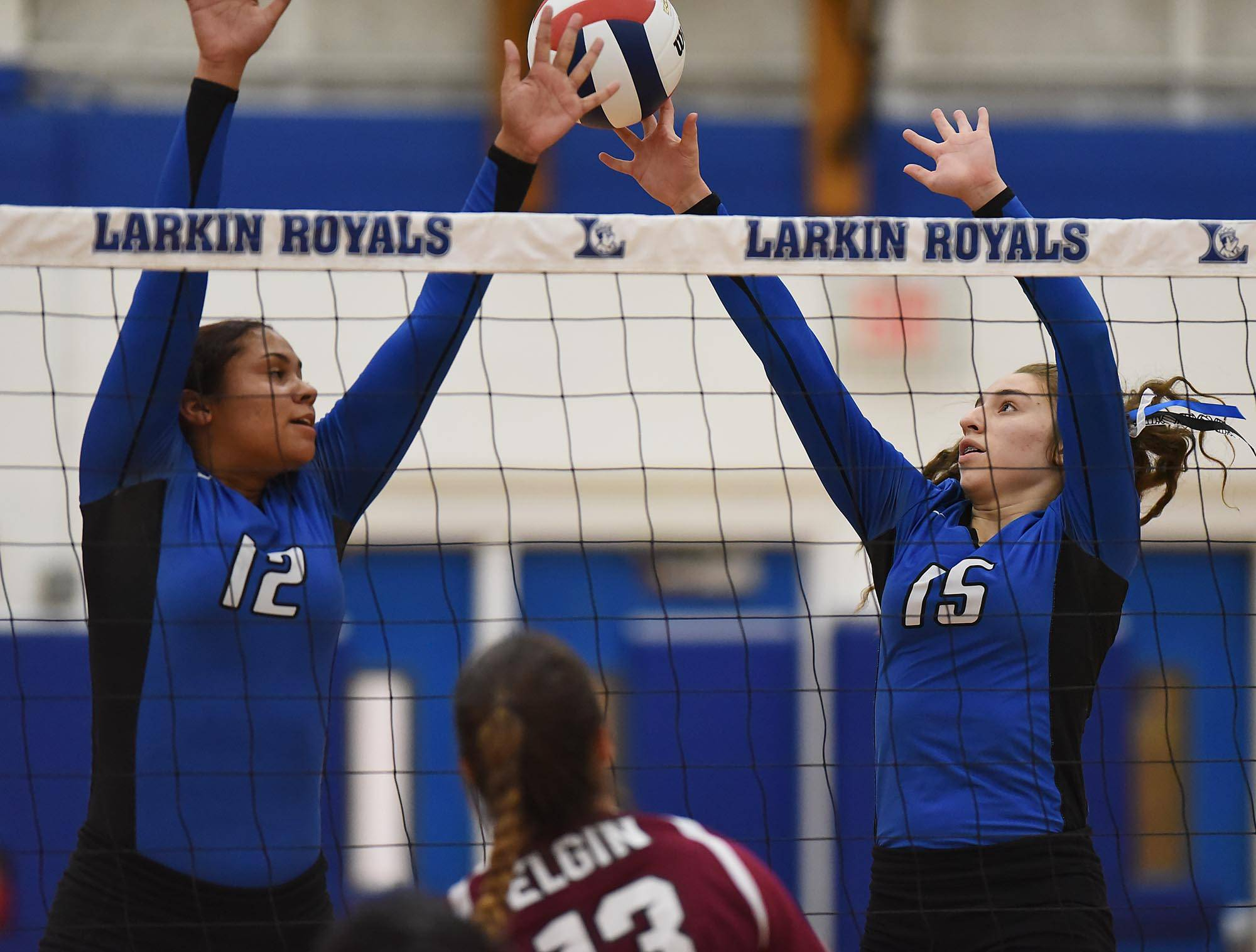 Larkin's Jaelihn Norman and Alexia Saldivar Elgin's Simona Simeonova gets a shot between Tuesday at Larkin High School in Elgin.