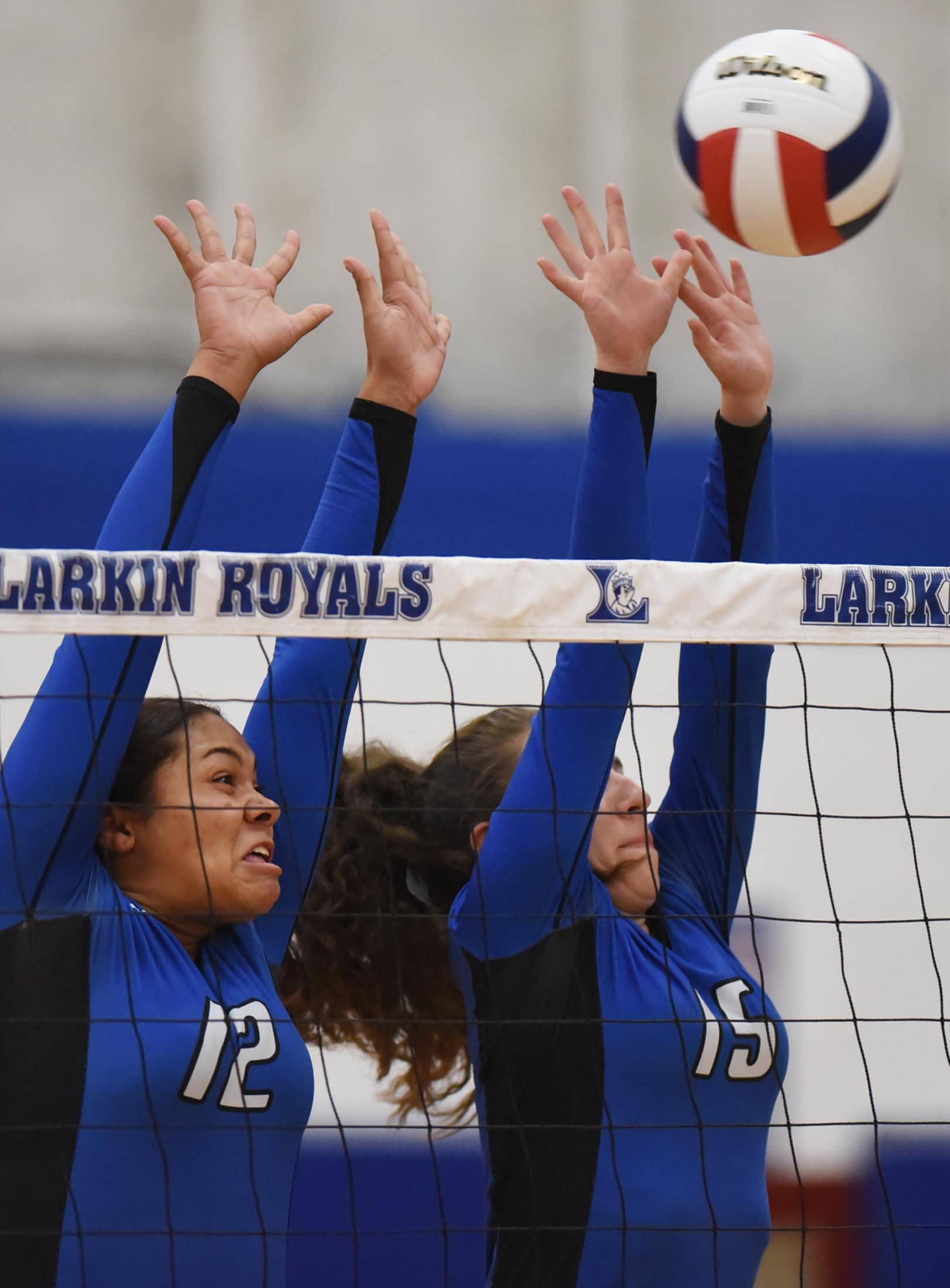 Larkin's Jaelihn Norman and Alexia Saldivar team up to block a shot by Elgin's Emily Graves Tuesday at Larkin High School in Elgin.