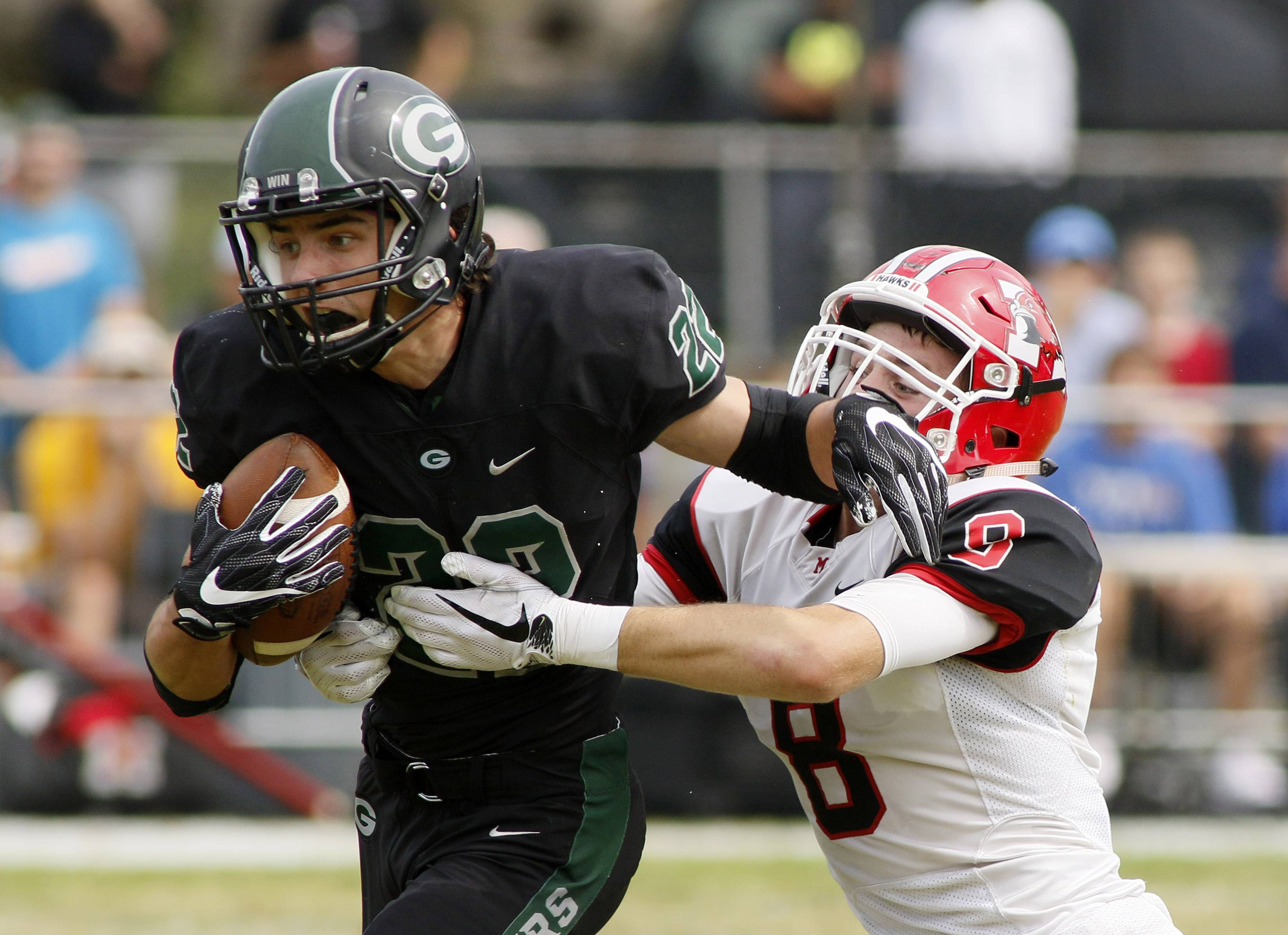 Glenbard West's Ryan Diver, left, runs for first half yardage past Maine South's Rory Hayes.