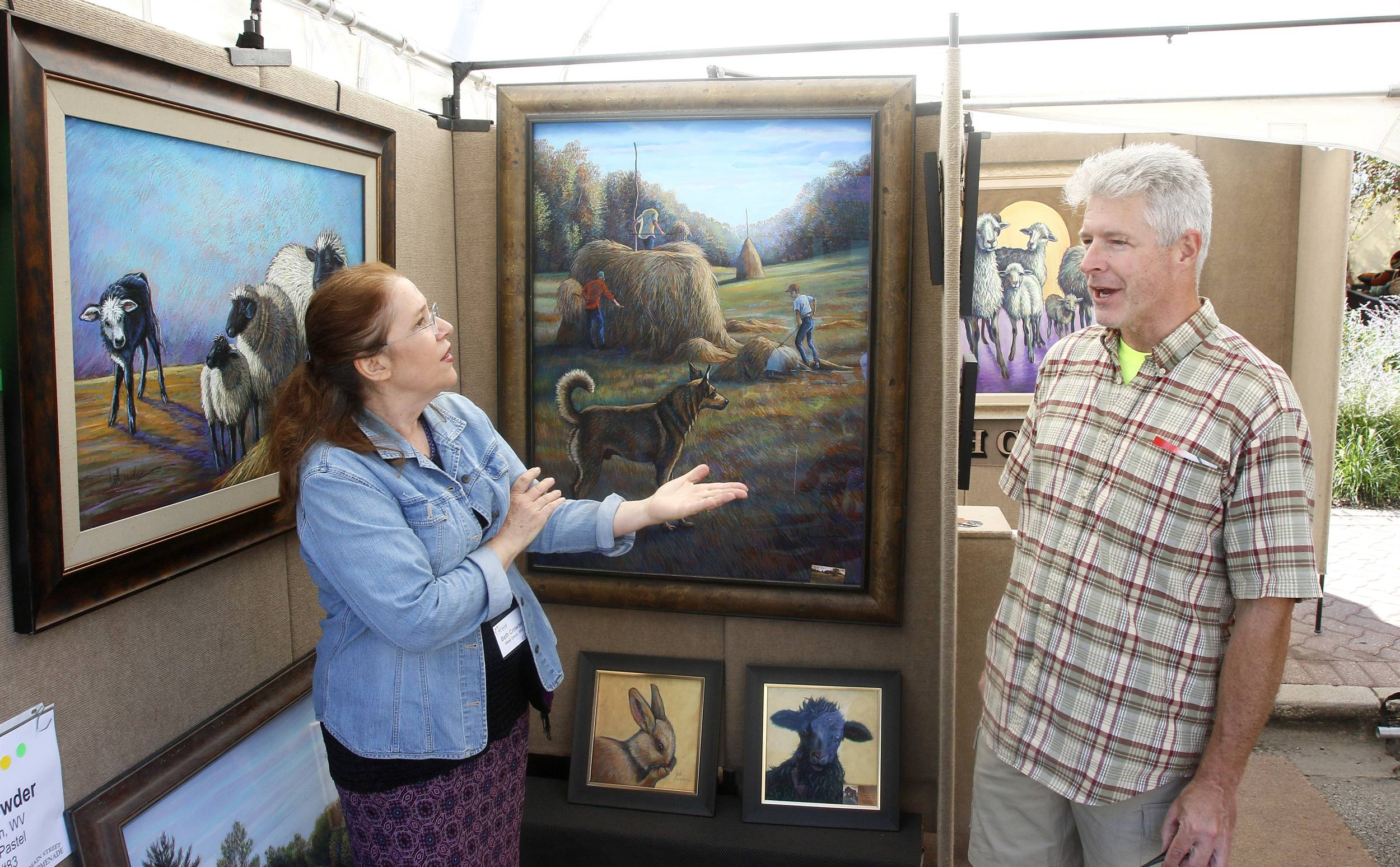 Speaking with artists is part of the fun of the Riverwalk Fine Art Fair for many art lovers who make the annual event a staple of their early fall calendar.