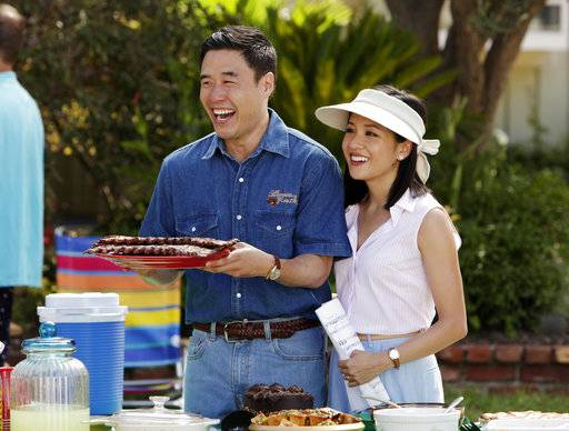 "In this image released by ABC, Randall Park, left, and Constance Wu appear in a scene from the new comedy series ""Fresh Off the Boat."" A new study finds that Asian-American characters are slighted on TV programs despite progress over the last decade. Professors and scholars at six California universities studied 242 broadcast, cable and digital platform shows that aired during the 2015-16 season. Following up on broadcast TV studies done in 2005 and 2005, the new report found increasing opportunities for Asian-American actors in shows including ""Fresh Off the Boat� and ""Master of None.� (AP Photo/ABC, Nicole Wilder)"