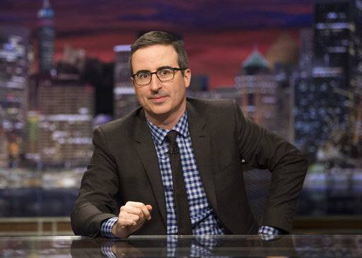 "This image released by HBO shows John Oliver, host of ""Last Week Tonight with John Oliver."" HBO says it has renewed the show for three additional seasons. (Eric Liebowitz/HBO via AP)"