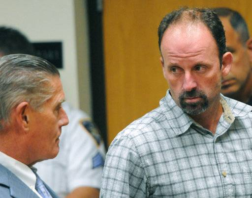 FILE - In this July 31, 2014 file photo, John Bittrolff, right, listens to his attorney William Keahon during his arraignment on murder charges in Riverhead, N.Y. Suffolk County Assistant District Attorney Robert Biancavilla said Tuesday, Sept. 12, 2017 that Bittrolff, convicted of killing two prostitutes in the 1990s may be responsible for at least one of the 10 unsolved killings of people along a Long Island beach highway. (James Carbone/Newsday via AP, Pool, File)