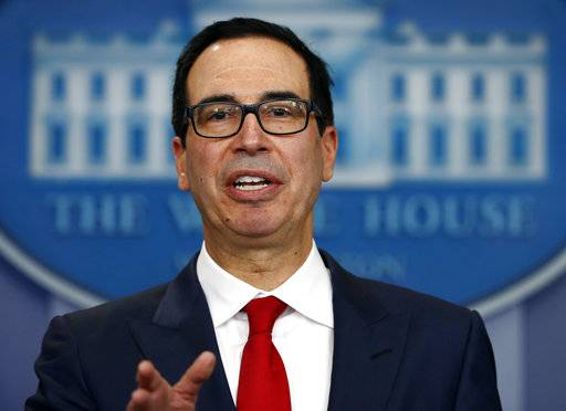 FILE - In this Aug. 25, 2017, file photo, Treasury Secretary Steven Mnuchin speaks at the White House in Washington. Congressional Republicans are scrambling to come up with a budget deal to clear the way for the first tax overhaul in three decades. (AP Photo/Carolyn Kaster, File)