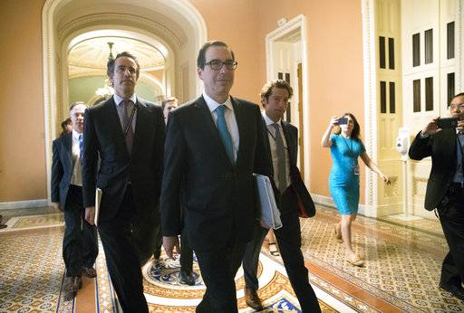 Treasury Secretary Steven Mnuchin arrives at the Capitol for a meeting with Senate Majority Leader Mitch McConnell, R-Ky, Trump's top economic adviser Gary Cohn, and members of the Senate Budget Committee as they struggle with a tax code overhaul, Tuesday, Sept. 12, 2017 in Washington. (AP Photo/J. Scott Applewhite)