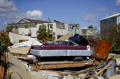 A bed sits amongst the remains of its room in a home demolished from Hurricane Irma in Goodland, Fla., Tuesday, Sept. 12, 2017. (AP Photo/David Goldman)