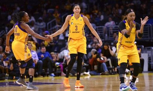 Los Angeles Sparks forward Nneka Ogwumike (30), forward Candace Parker (3) and guard Odyssey Sims (1) celebrate late in the first half of a WNBA basketball playoff game against the Phoenix Mercury, Tuesday, Sept. 12, 2017, in Los Angeles. The Sparks won 79-66. (Stephen Carr/Los Angeles Daily News via AP)