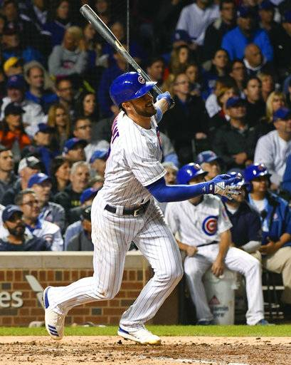 Chicago Cubs' Kris Bryant watches his three run home run against the New York Mets during the fourth inning of a baseball game in Chicago, Tuesday, Sept. 12, 2017. (AP Photo/Matt Marton)