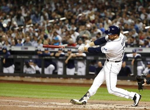 Tampa Bay Rays' Lucas Duda hits a double during the first inning of a baseball game against the New York Yankees on Tuesday, Sept. 12, 2017, in New York. (AP Photo/Frank Franklin II)