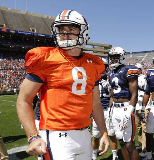FILE - In this April 8, 2017, file photo, Auburn quarterback Jarrett Stidham (8) is on the sideline during the annual A-Day spring game, in Auburn, Ala. No. 15 Auburn's offense is struggling even with a new coordinator and quarterback, especially in passing and protecting Jarrett Stidham. (AP Photo/Todd J. Van Emst, File)