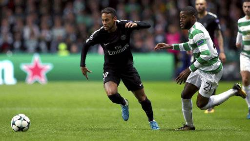 PSG's Neymar, left, and Celtic's Olivier Ntcham, right, challenge for the ball during the Champions League Group B soccer match between Celtic and Paris St. Germain at the Celtic Park stadium in Glasgow, Scotland, Tuesday, Sept. 12, 2017. (AP Photo/Scott Heppell)
