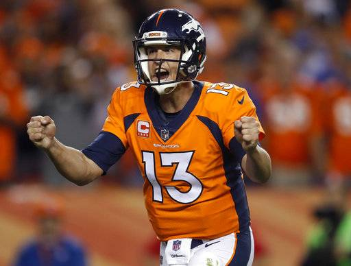 Denver Broncos quarterback Trevor Siemian (13) celebrates against the Los Angeles Chargers during the second half of an NFL football game, Monday, Sept. 11, 2017, in Denver. (AP Photo/David Zalubowski)