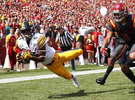 Iowa wide receiver Ihmir Smith-Marsette (6) catches a 15-yard touchdown pass ahead of Iowa State defensive back Evrett Edwards, right, during the second half of an NCAA college football game, Saturday, Sept. 9, 2017, in Ames, Iowa. Iowa won 44-41 in overtime. (AP Photo/Charlie Neibergall)